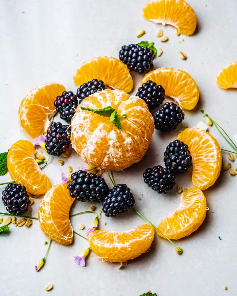 Flat lay of soft citrus and blackberries